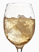 White wine glass with ice cubes