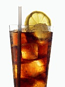 Cola with ice cubes, slice of lemon and straw in glass
