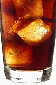 Cola with ice cubes in glass (detail)
