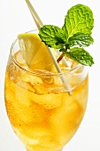 Cold peppermint tea with fresh mint and lemon