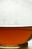 Hot fruit tea in glass teapot (detail)