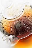 Hot tea in glass teapot