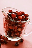 Cranberries in measuring jug