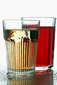 Cranberry juice and apple schorle in glasses