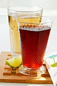 Apple juice and cranberry juice; wedge of lime