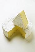 Brie, a piece cut off