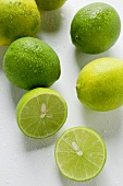 Fresh Key limes with drops of water