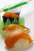 Sushi with salmon, shrimp and caviare; soy sauce