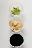 Sushi accompaniments: soy sauce, ginger and wasabi