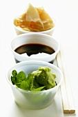 Sushi accompaniments: soy sauce, ginger and wasabi