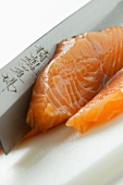 Cutting salmon for sushi