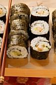Assorted maki-sushi with chopsticks
