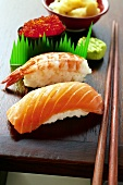 Nigiri-sushi and gunkan-maki with wasabi and ginger