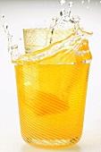 Tonic with lemon splashing out of glass