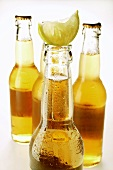 A few bottles of Ginger Ale with wedge of lemon