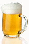 Lager in tankard, frothing over
