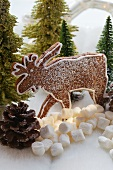 Chocolate elk biscuit in winter forest