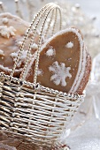Orange biscuits with snow crystals in silver basket
