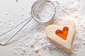 Sweet pastry heart with apricot jam and icing sugar