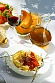 Pasta with tomato sauce; sweet melon; wine; tomato salad
