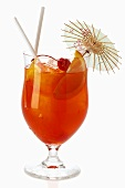 Fruit cocktail in cocktail glass with straws and parasol