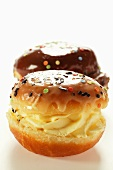 Two doughnuts with vanilla cream filling and glacé icing