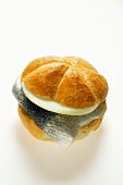 Bread roll with rollmops and onion