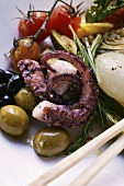 Antipasti platter of marinated vegetables and octopus