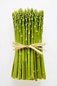 Bundle of green asparagus with drops of water