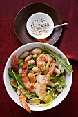 Bean stew with shrimps and rocket