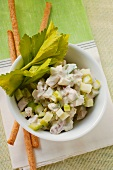 Chicken salad with celery; grissini