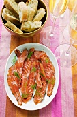 Graved lachs with dill; baguette; champagne
