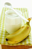 Jar of yoghurt and fresh banana