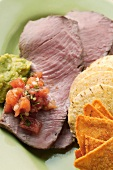 Roast beef with tomato salsa, guacamole and tortilla chips
