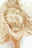 Flour with wooden scoop
