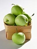 Granny Smith apples in chip basket