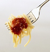 A forkful of spaghetti with tomato sauce
