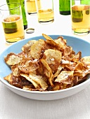 Home-made potato crisps; beer