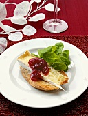 Melted Brie with cranberry sauce on toasted bread