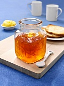 Jar of orange marmalade, toast and butter