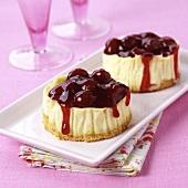 Mini-cheesecakes with cherry sauce