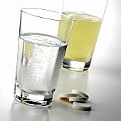 Dissolving effervescent vitamin C tablets in water