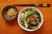 Glass noodles with beef and vegetables; chopped peanuts