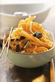 Raw carrot salad with pumpkin seeds
