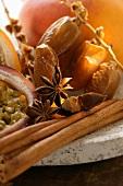 Still life with dates, star anise, cinnamon, granadilla & mango