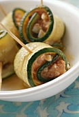 Courgette rolls with mozzarella and tomato filling