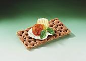 Crispbread with butter, mozzarella, tomato and basil