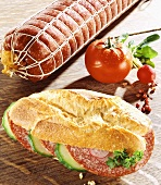 Salami, cucumber and radishes in a baguette