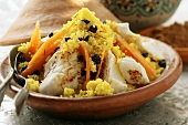 Saffron couscous with fish, carrots and raisins (N. Africa)