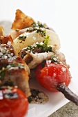 Barbecued pork kebabs with cherry tomatoes